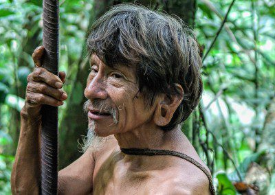 Old Huaorani warrior with his blowpipe