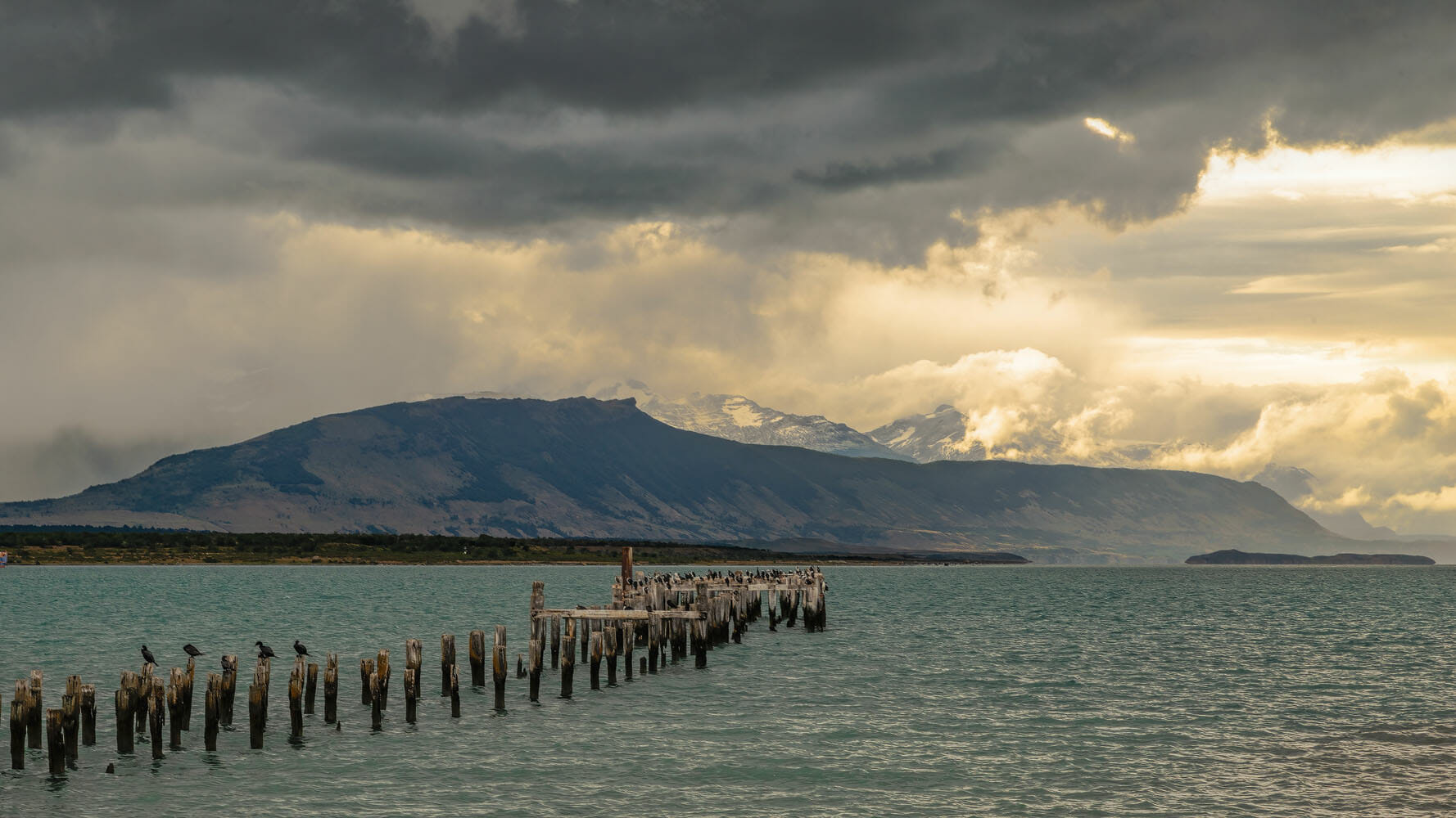 Abandoned wooden pier at Puerto Natales - Chilian Patagonia