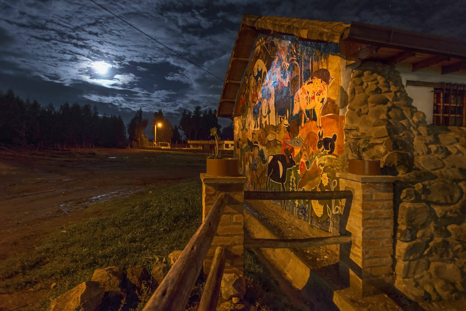 The moonlighted rear facade of the La Moya church decored with typical Andean painting