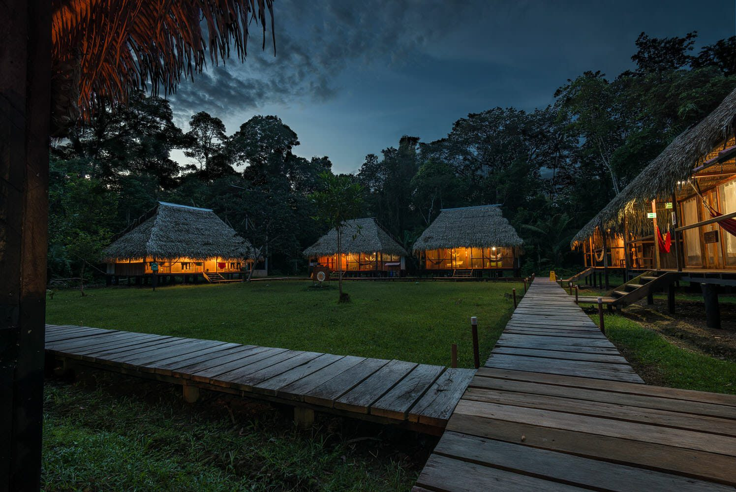 Cabins of the Nicky Lodge at twilight. Cuyabeno Amazon national park