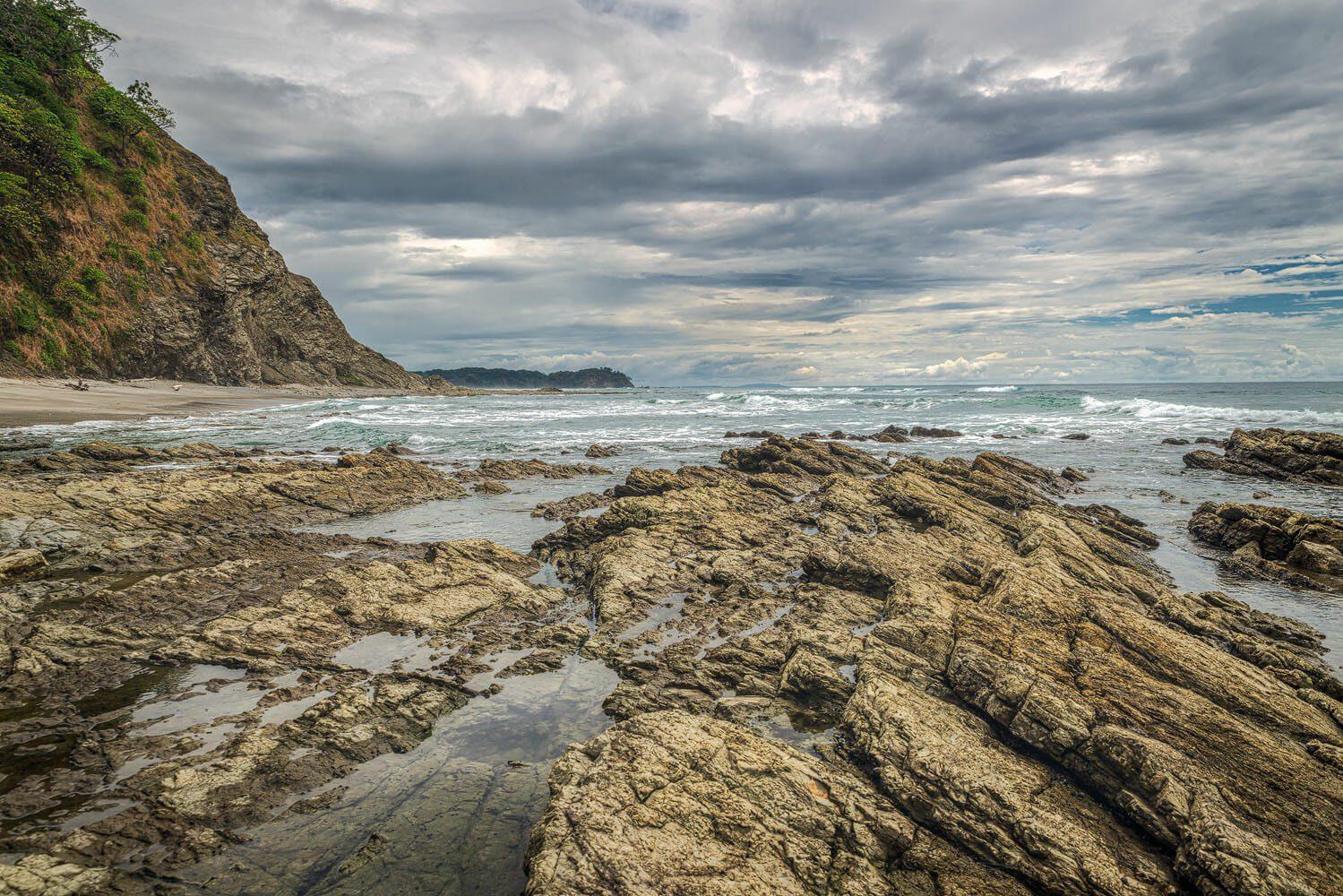 Beautiful cloudy sky on the rocky peninsula of playa bonita - Costa Rica