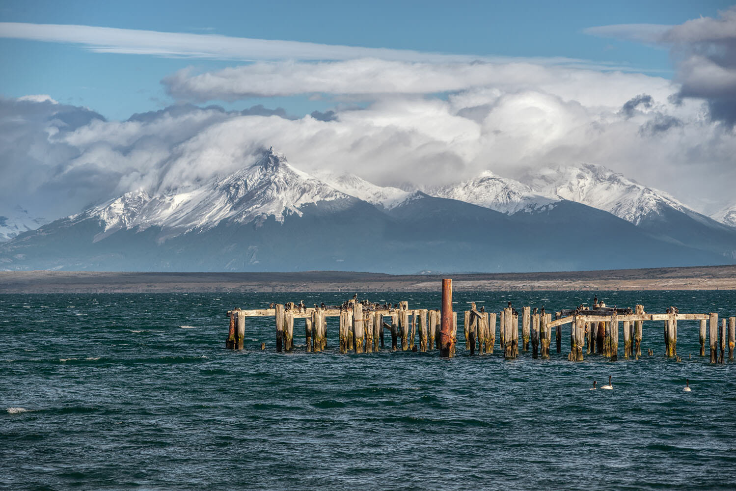 Braun & Blanchard pier in Puerto Natales and mountain range in the background