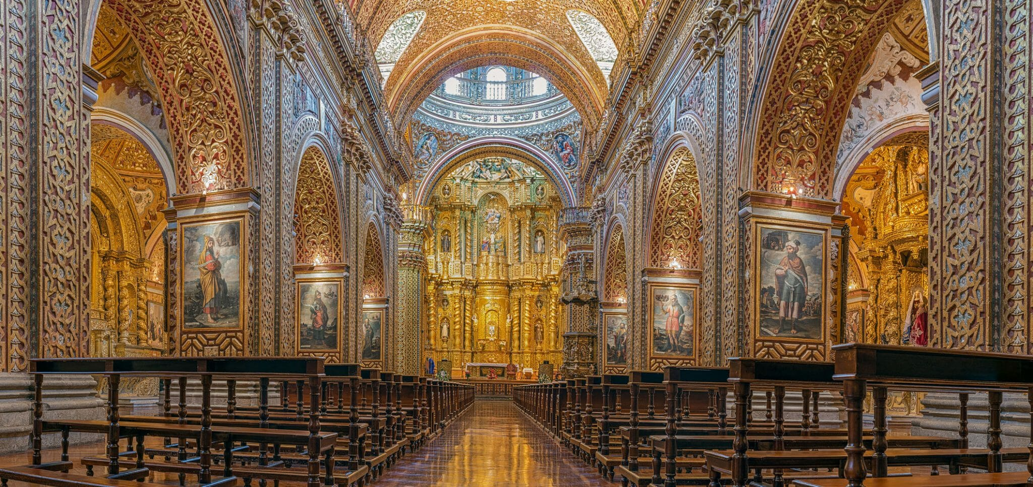 Panoramic view of the central nave La Compania Jesuit church in Quito