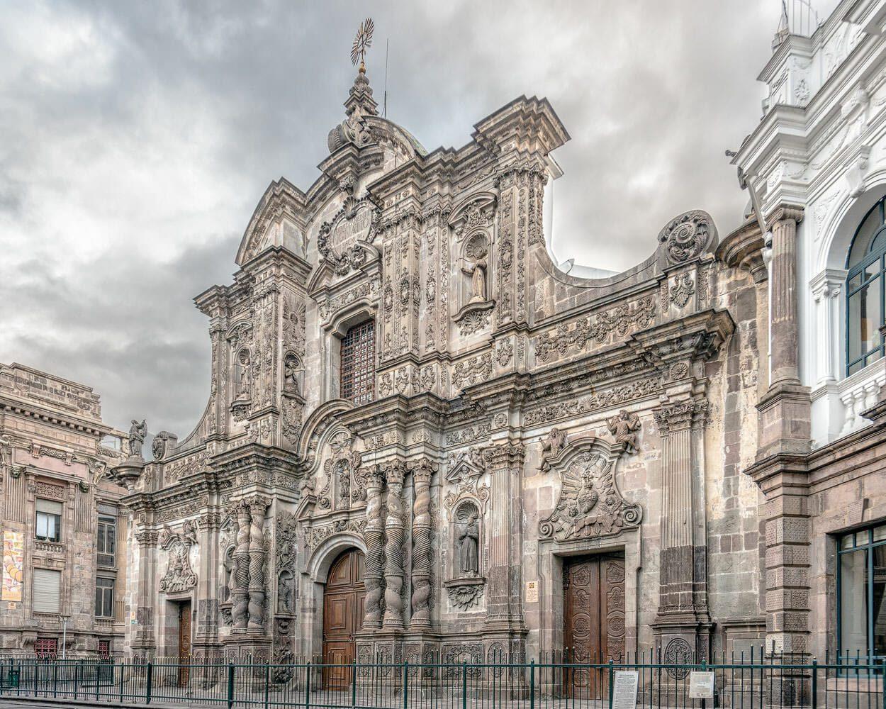 Quito facade of La Compania Jesuit church 6:30 AM